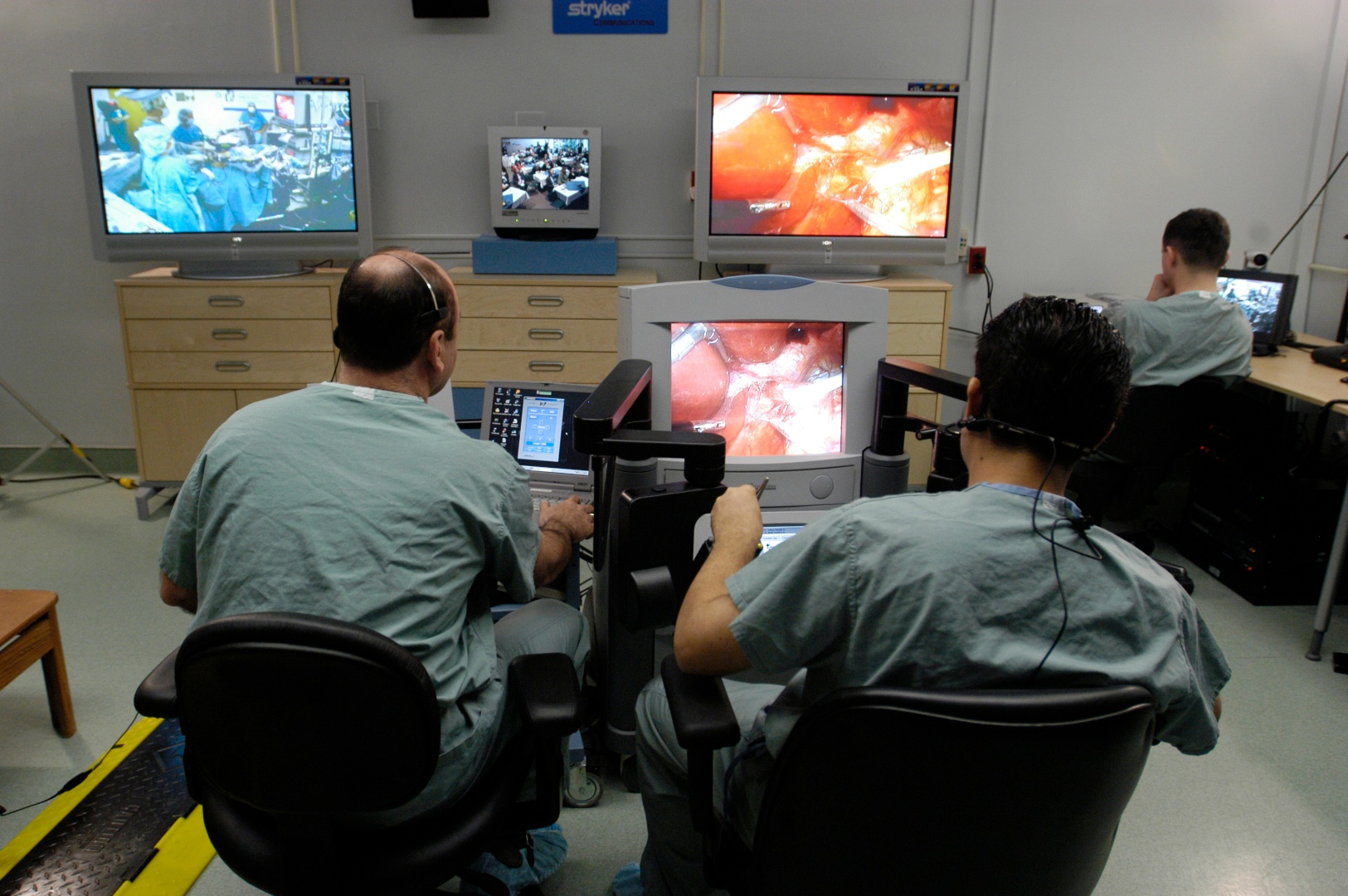 Doctors using telementoring equipment
